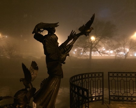 Girl releasing dove in Fog along Brush Creek, Plaza.jpg